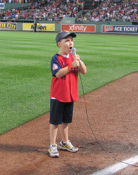 "Boy giving the ""play ball!"" command at a Red Sox game. Image from AutismSpeaks.org"
